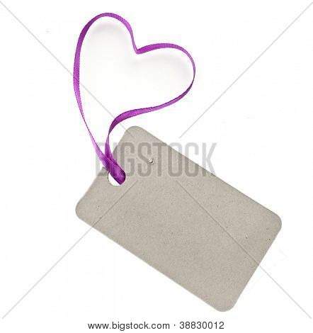 cardboard tag with pink heart ribbon  isolated on white background