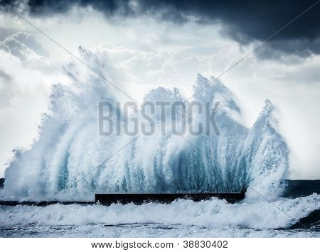 Giant wave splash, beautiful dark dramatic seascape