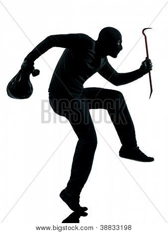 thief criminal walking quiet in silhouette studio isolated on white background