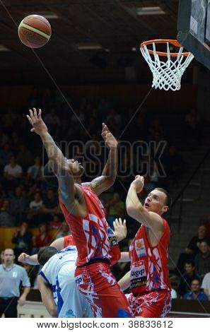 KAPOSVAR, HUNGARY - OCTOBER 20: Unidentified players in action at Hungarian National Championship basketball game with Kaposvar (white) vs. Nyiregyhaza (red) on October 20, 2012 in Kaposvar, Hungary.