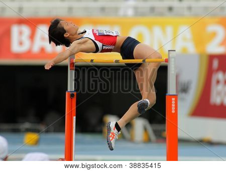 BARCELONA - JULY, 13: Midori Kamijima of Japan jumping on Hight jump event of of the 20th World Junior Athletics Championships at the Olympic Stadium on July 11, 2012 in Barcelona, Spain