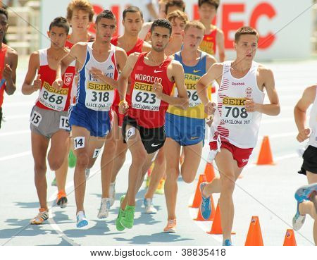 BARCELONA - JULY, 13:Competitors of 3000m steeplechase event during the 20th World Junior Athletics Championships at the Olympic Stadium on July 13, 2012 in Barcelona, Spain