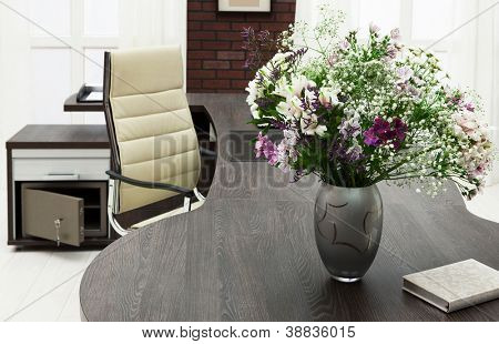 bouquet of flowers on a desk