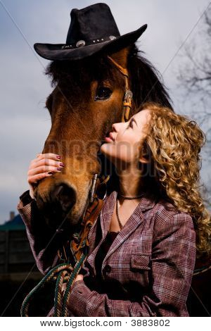 Lovely Blond Woman Standing By Horse