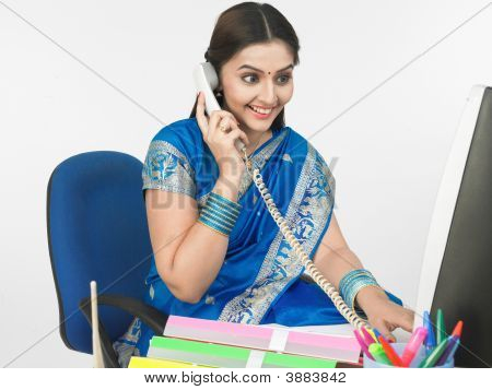 Female Manager Of Indian Origin Talking On The Phone