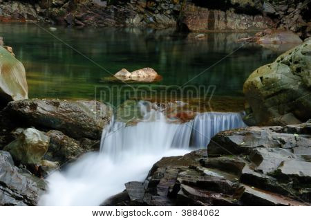 Wild Stream Flowing Through Rocks