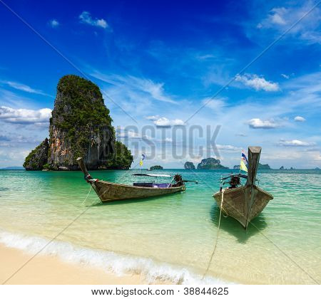 Long tail boats on tropical beach, Krabi, Thailand