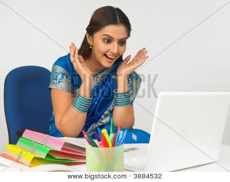 Asian Business Executive Working In Her Office