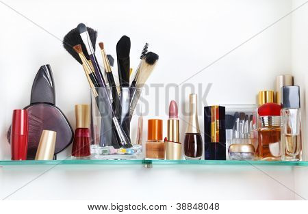 white bathroom shelf with cosmetics and  toiletries