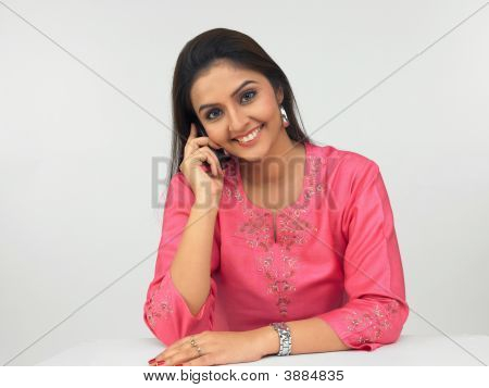 Asian Girl Talking On Her Cell Phone