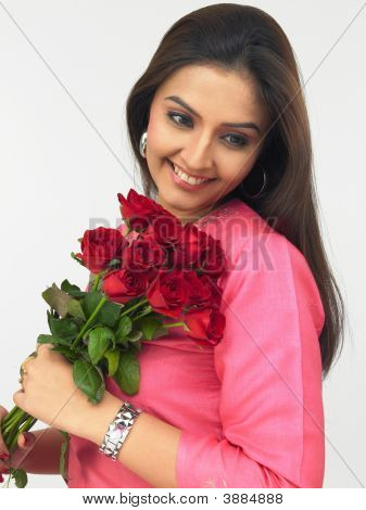 Young Indian Woman With A Bouquet Of Roses
