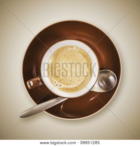 An image of a brown cup of coffee