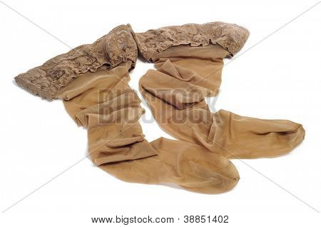 sexy beige stay-up stockings on a white background