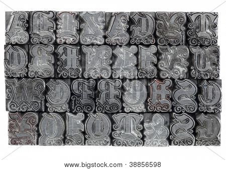 random alphabet letters in decorative metal letterpress type - initials font
