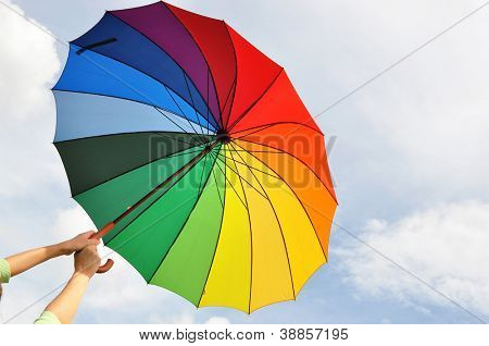 Rainbow umbrella in the hands