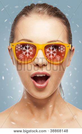 teenage girl in shades with expression of surprise