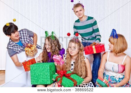 Happy teens group with presents
