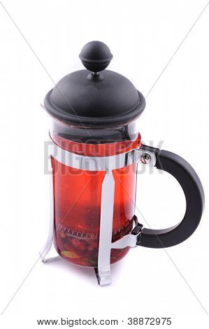 French press with hot berries tea on white
