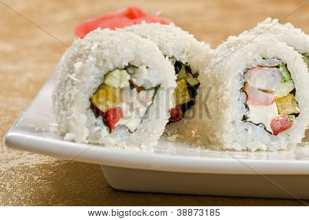 sushi roll of shrimp, cucumber, pepper and sauce, closeup