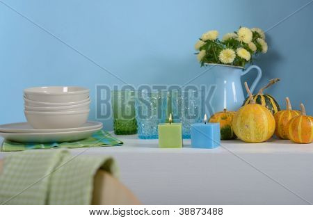 Sideboard with Thanksgiving decorations and dishware