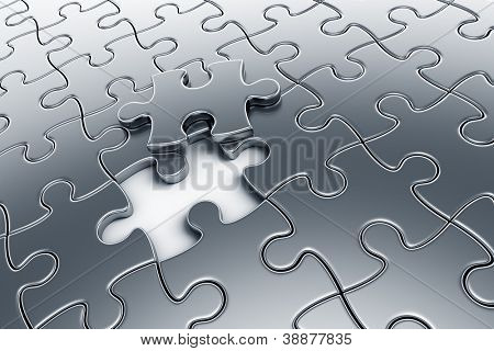 3d rendering of silver puzzle pieces with one piece lifted up