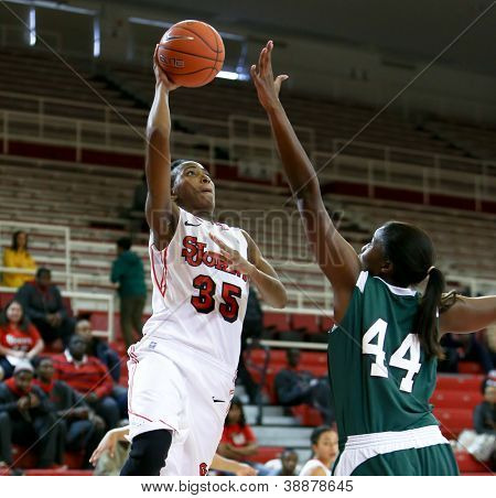 NEW YORK-NOV 3: St. John's Red Storm guard Shenneika Smith (35) shoots over Farmingdale Rams center Wabiyn Ati at Carnesecca Arena on November 3, 2012 in Jamaica, Queens, New York York.