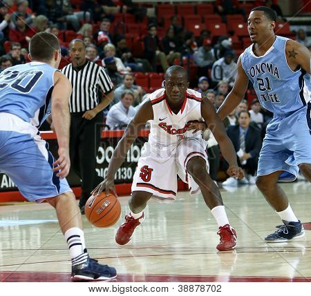 NEW YORK-NOV 3: St. John's Red Storm center Chris Obekpa (12) shoots over Sonoma State Seawolves guard Jason Walter (3) at Carnesecca Arena on November 3, 2012 in Jamaica, Queens, New York.