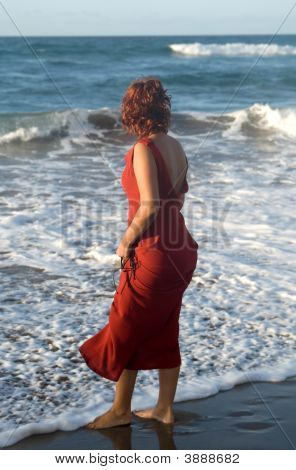 Woman In The Seaside In The Beach