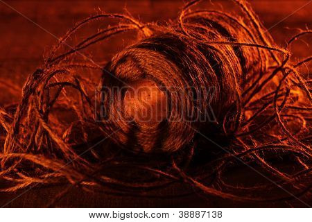 Spool of thread on wooden surface in beautiful artistic image