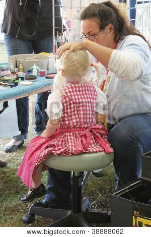 TULSA, OK - OCT 20: Young Oktoberfest goer gets her face painted at Oktoberfest in TULSA, OK, on October 20, 2012 in TULSA, OK. Tulsa is the origin of the first Oktoberfest Chicken Dance in the U.S.