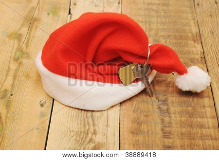 Santa's key with blank label  on old wooden table