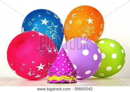 Colorful party items on white background