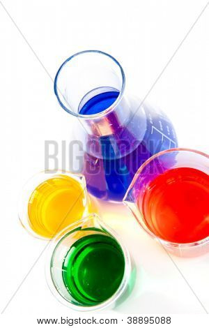 Three beakers and an erlenmeyer against a white background