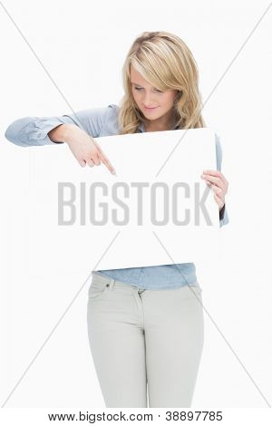 Woman pointing on the piece of paper while holding it