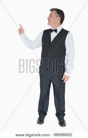 Man in suit pointing something above him