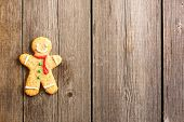 foto of ginger man  - Christmas homemade gingerbread man over wooden table - JPG