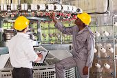 pic of loom  - textile factory manager and worker checking yarn on weaving machine - JPG