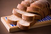 foto of whole-wheat  - A loaf of sliced whole wheat bread