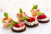 stock photo of canapes  - Holiday Appetizers on the platter - JPG