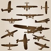 High resolution vintage old set of brown planes drawings on a beige background. It is a group or col
