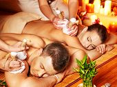 picture of thai massage  - Man and woman getting herbal ball massage in bamboo spa - JPG