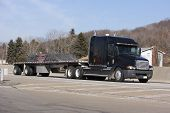 image of semi-truck  - flatbed truck on the highway - JPG