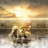 stock photo of revelation  - Fantastical glowing golden lion statue with wings in majestic heavenly setting - JPG