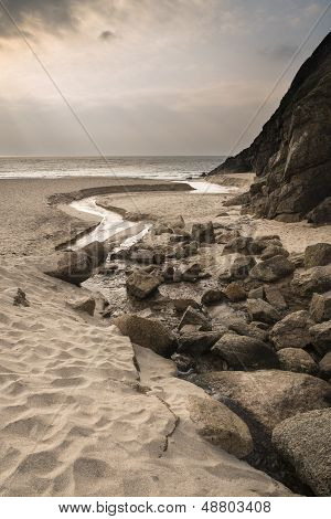 Porthcurno yellow sand beach before sunset Cornwall England