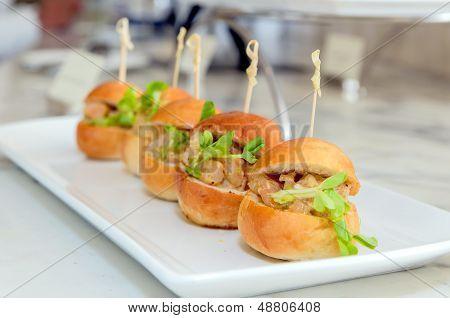 Mini Hamburger On White Dish