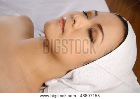 Asian Woman Relaxing On The Spa