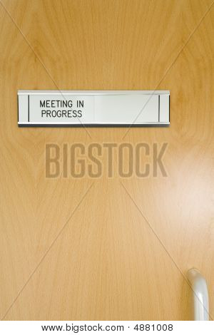 A 'meeting In Progress' Sign