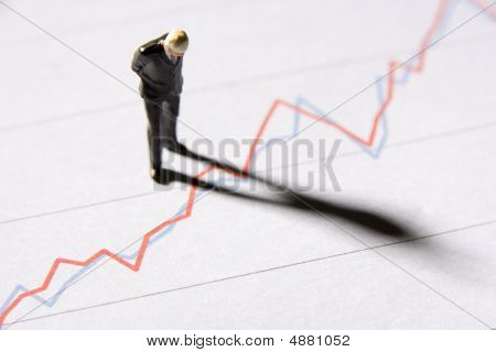 Line Graph With Businessman Figurine