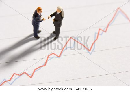 Line Graph With Businessmen Figurines