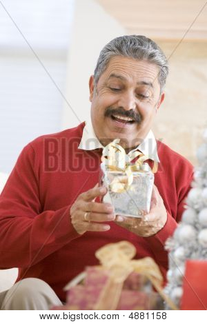 Man Excited To Open Christmas Present